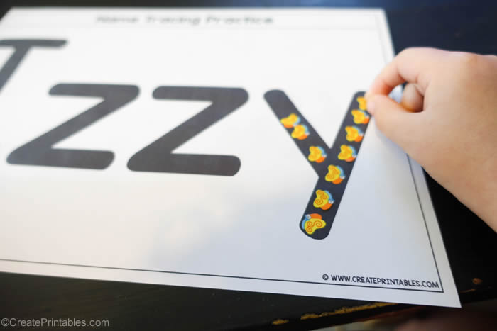 name tracing worksheet with stickers